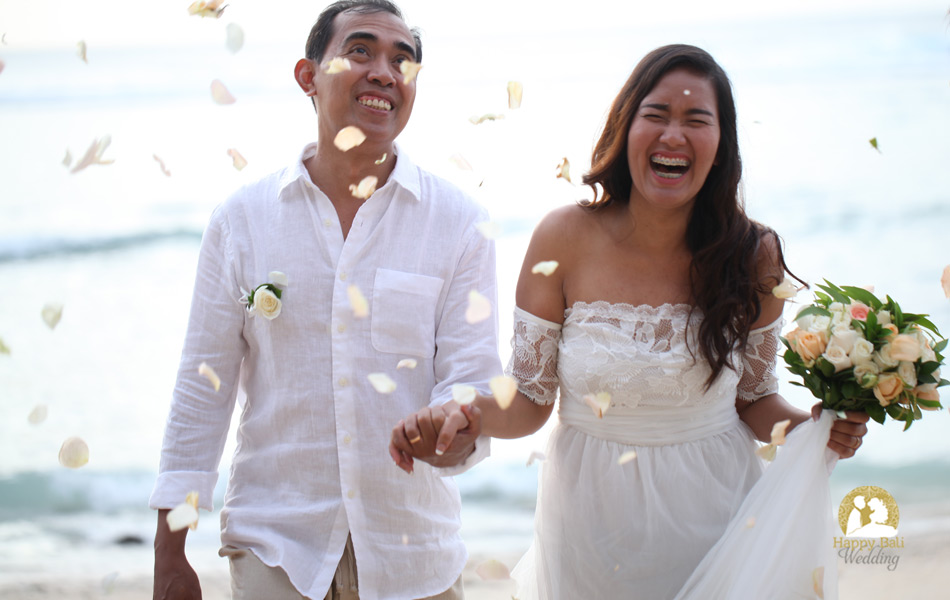 happy wedding couple in balangan beach - bali wedding